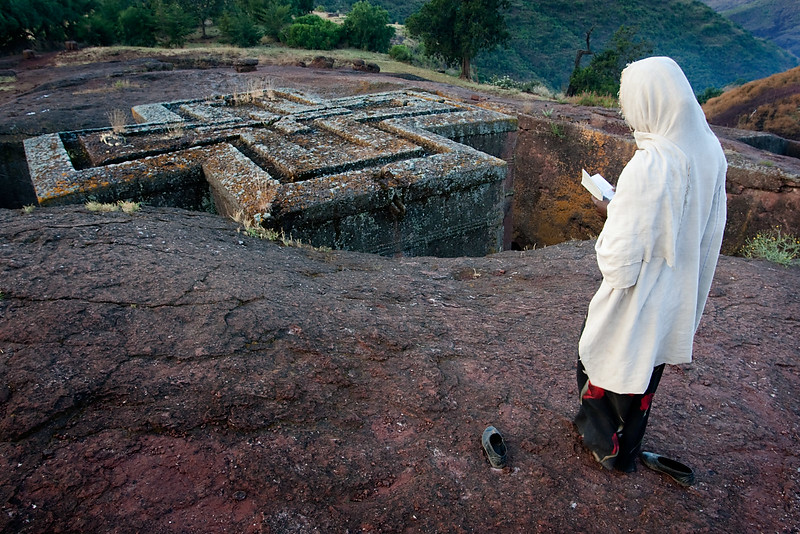 Pilgrim at Bet Giyorgis rock hewn church at dawn - Lalibela