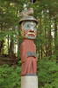 Man wearing Bear Hat pole is a Tlingit grave marker at Totem Bight State Historical Park