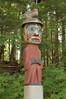Man wearing Bear Hat pole is a Tlingit grave marker at Totem Bight State Historical Park
