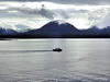 A small boat heading home through the Tongass Narrows as the light fades away