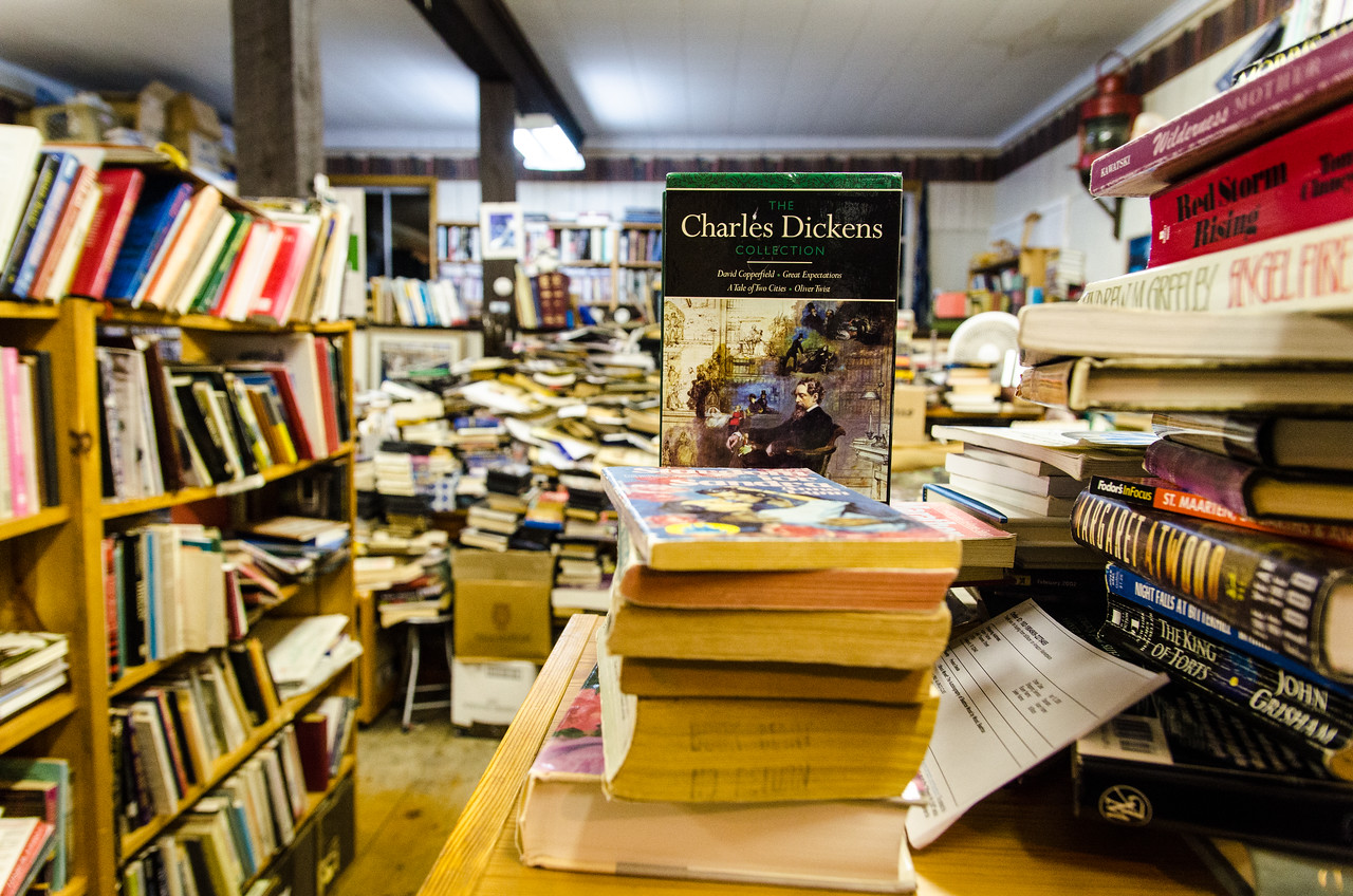 Books are stacked everywhere, it's a little chaotic, but fun.