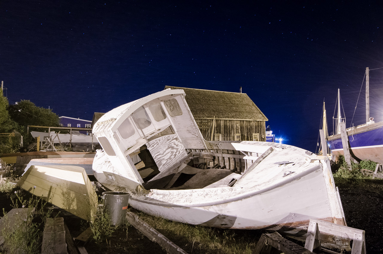 Abandoned boat, Lunenberg waterfront by moonlight.
