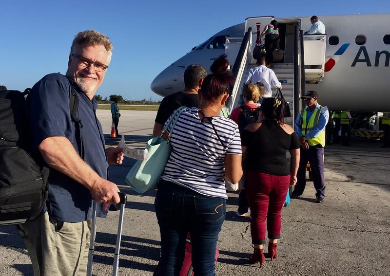 Richard prepares to board our AA flight to Miami.