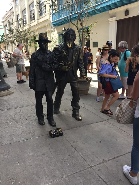 """The Gentleman from Paris."" This bronze statue depicts a former Spanish resident who was sent to jail for a crime he didn't commit. In jail he went crazy. When he was released he became homeless and wandered the streets. When people would give him food, he would give poems back in return. In his madness he would tell people,"" I'm not a beggar, I'm a gentleman from Paris."""