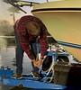 Jim McKeeman secures the boat to the trailer.<br /> Huntington Harbor, California<br /> January 9, 2021