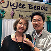 "Judy Carlson, Jujee Beads owner/artist, presenting Kevin Lee with her glass nudibranch creation, ""Placida kevinleei"".<br /> Scuba Show, Long Beach, California<br /> June 23, 2018<br /> Photo by Mike Couffer"