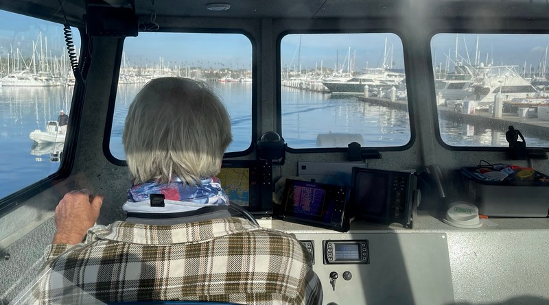 Jim Simmerman, Captain, at the helm of The Giant Stride<br /> Cabrillo Way Marina, San Pedro, California<br /> December 12, 2020
