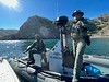 "Fish and Game Wardens check us out. ""The only thing we're shooting is our cameras"".<br /> Willow Cove, Catalina Island, California<br /> January 9, 2021"