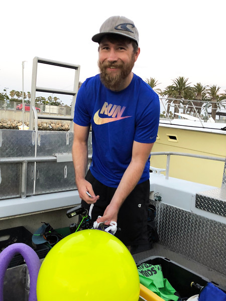 Aaron prepping our buoy with lights<br /> Black Water (night) dive, off Palos Verdes, California