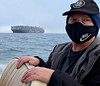 Mike Bartick, watches as fog begins to lift<br /> Catalina Channel, California<br /> January 9, 2021