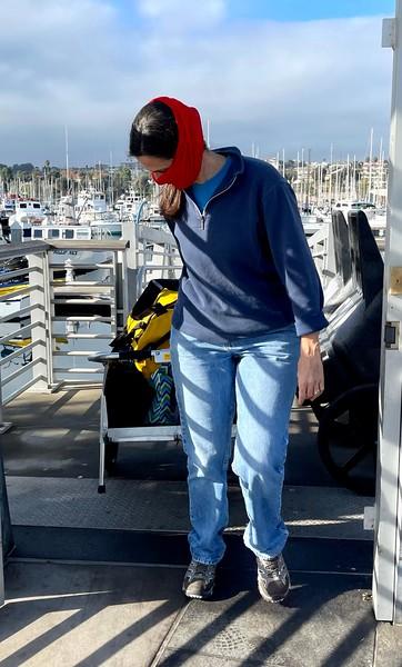 Dana Rodda, hauling dive gear.<br /> Cabrillo Way Marina, Los Angeles Harbor<br /> San Pedro, California<br /> December 12, 2020