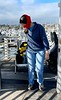 Dana Rodda, hauling dive gear.<br /> Cabrillo Way Marina, Los Angeles Harbor<br /> San Pedro, California<br /> December 12, 2020