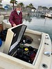 Jim McKeeman checks out the engine.<br /> Huntington Harbor, California<br /> January 9, 2021