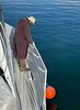 Jeff Reeb preps Giant Stride for docking<br /> Cabrillo Way Marina, San Pedro, California<br /> December 12, 2020