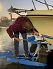 Jim McKeeman secures the boat to the trailer.<br /> Huntington Harbor, California<br /> January 9, 2021