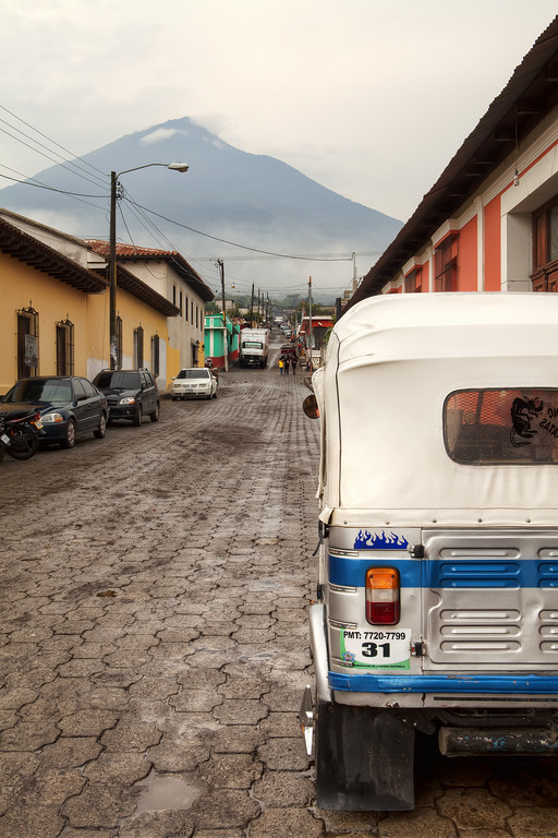 tuk tuk and volcano near antigua guatemala