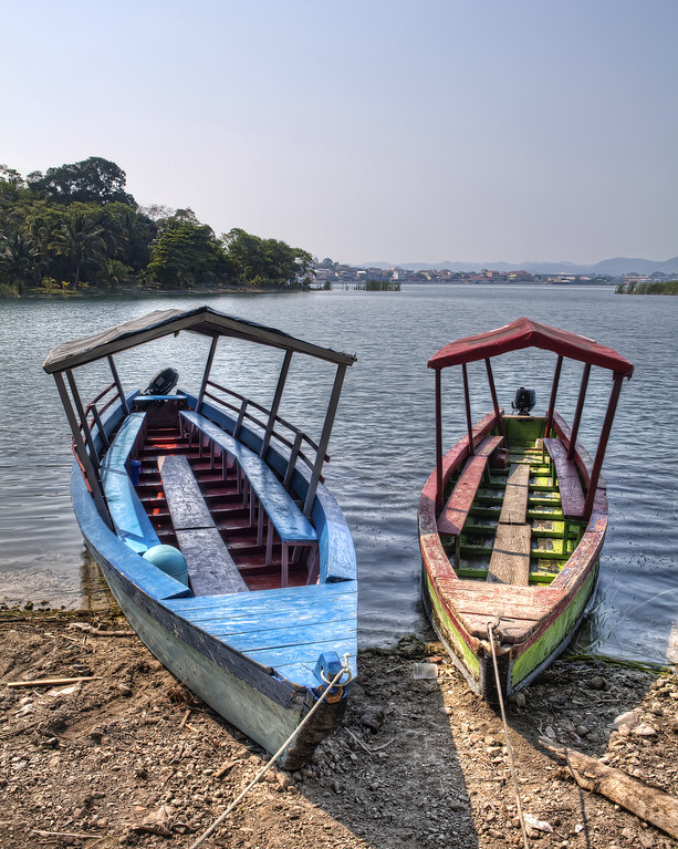 Two traditional launches or boats on the shores of lake petin itza, Guatemala