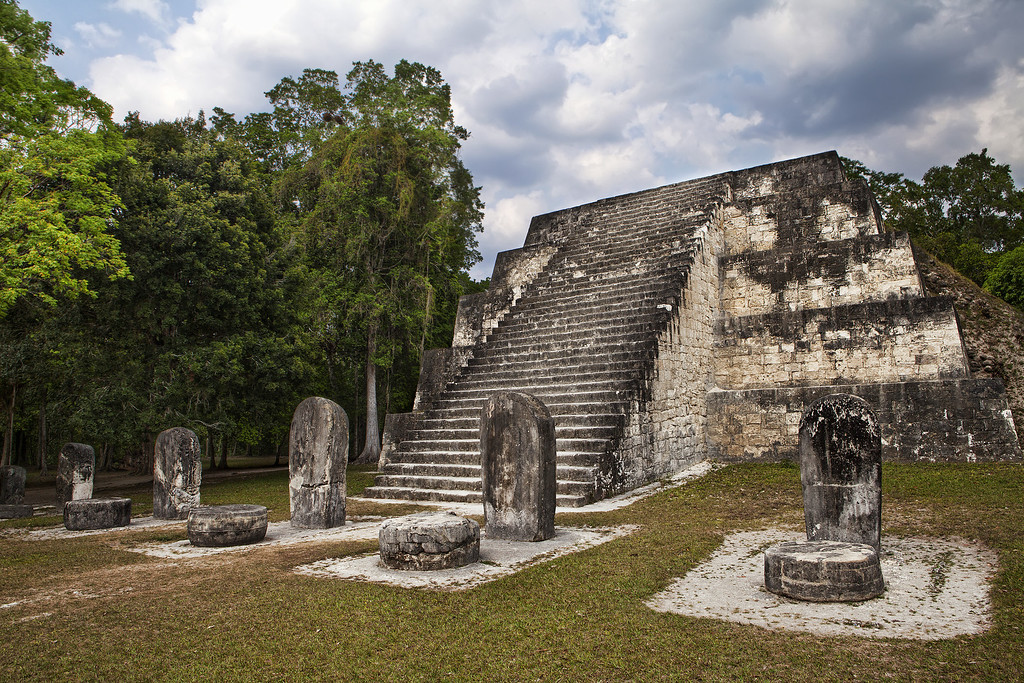 temple and stele at tikal, guatemala