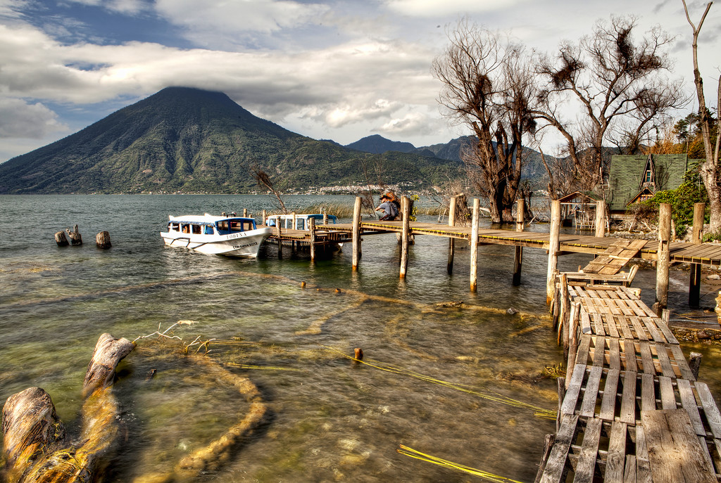 Boat dock and looming volcano over the waters of Lake Atitlan, Guatemala