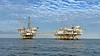 Oil Rig Platforms: Ellen (left) & Elly.  <br /> Catalina Channel, Giant Stride<br /> March 18, 2021<br /> <br /> Platform Elly<br /> District: California,  Location: Offshore Long Beach, CA<br /> Installed: 03-12-80,  Lease OCS-P 0300, First Production: None, as this is a processing facility,  Distance to Land: 8.6 miles, Well Slots: NA<br /> Water Depth: 255' <br /> Platform Elly is connected by a walkway to Platform Ellen, as shown in the photo above. Elly processes production from Platforms Ellen and Eureka.<br /> Platforms Operated by Beta Operating Company, LLC