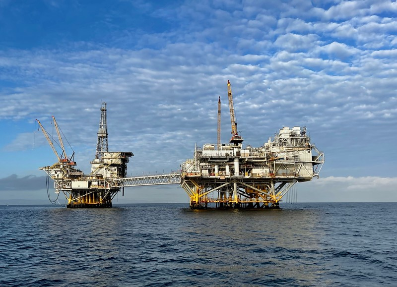 Oil Rig Platforms: Ellen (left) & Elly.  Ellen is a production platform connected by walkway to Platform Elly, which is a processing platform for both Ellen and Eureka.<br /> Catalina Channel, Giant Stride<br /> March 18, 2021<br /> <br /> Platform Ellen<br /> District: California,  Location: Offshore Long Beach, CA<br /> Installed: 01-15-80, Lease OCS-P 0300, First Production: 1-13-1981, Distance to Land: 8.6 miles, Well Slots: 80, Water Depth: 265', Cum. Oil Production: 49,357,000 bbls,  Cum. Gas Production: 16,501,000 mcf. Cumulative production listed, as of October 1, 2017<br /> Platforms Operated by Beta Operating Company, LLC