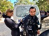 Sarah Pulitzer, DM & guide for Dos Ojos cenote, helps Daniel Mariscal with dive gear.