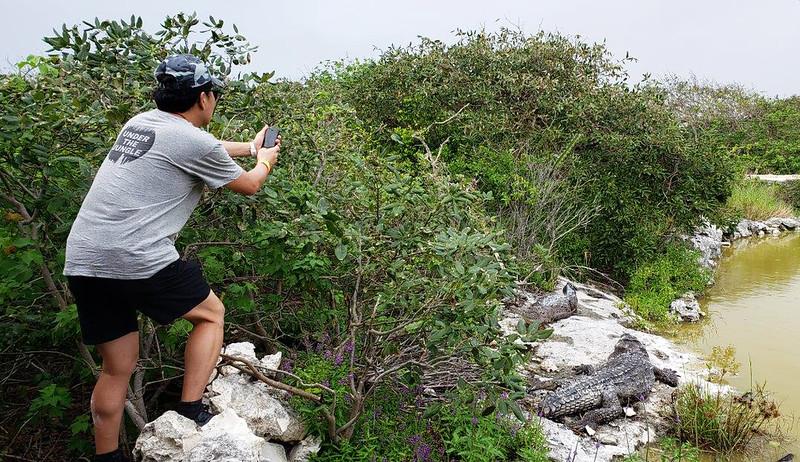 Kevin shooting crocs on Cozumel<br /> Photo by Scott Warner