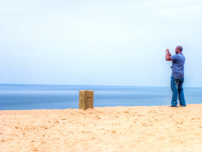 man taking photo at beach