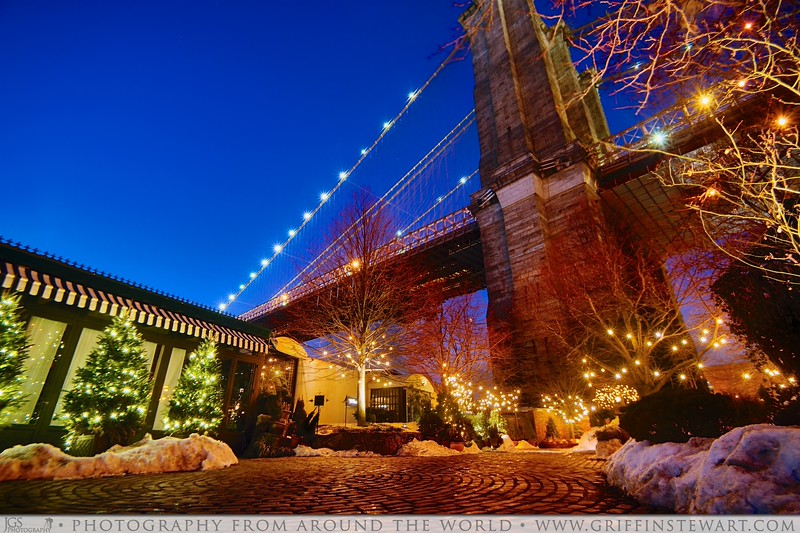 Went out last night to get some pictures of the Brooklyn bridge in with the snow around it.  Here is one picture of a very fancy restaurant that is nestled right underneath the bridge on the Brooklyn side.  It is called Cafe on the River and they server a four course meal for about $115 per person which I have heard is delicious.