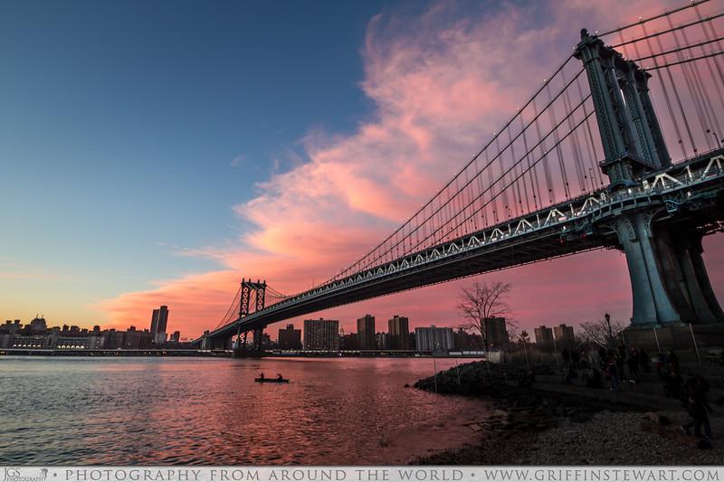 Boat Under The Manhattan Bridge At Sunset