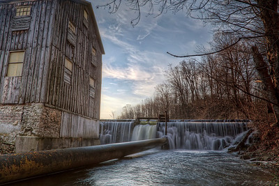 The Old Gristmill  If it looks like I'm standing in the water here it's because I am. Well, not really. My camera was though. I spotted this weir next to this old mill above Walter's Falls in Ontario. After failing to be satisfied with a shot from the bridge I went clambering down the bank, through branches covered in thorns to get down to the river edge. I landed heavily on a pair of rocks which immediately gave way under me....  Click here for more on this shot at the Traverse Earth blog.  If you're interested in my HDR techniques, visit my FREE HDR TUTORIAL.