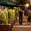 Couple walk down Queens street