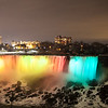 "The ""American Falls"" lit up at night"