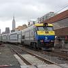 An EMD DE30AC propels a Long Island Railroad serive into Long Island City, New York.