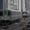 Two 'L' trains head north at Adams/Wabash, Chicago on the 27th March 2012.