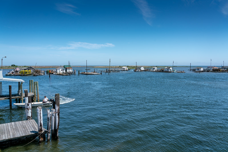 Looking northeast from the dock in Tangier. Past the crab shacks you can see the low lying wetlands know as the Uppards.