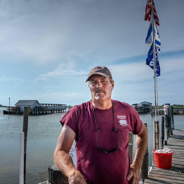 Ooker on the dock of his crab shack.