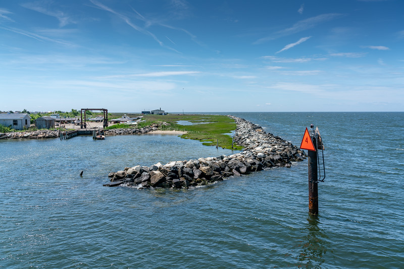 The rock seawall protects the western shore of Tangier Island from erosion. The islanders would like to have it surround the island, but no one is willing to put up the money.