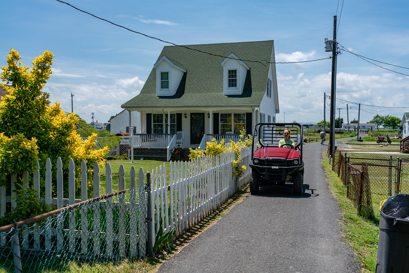 Folks get around on golf carts and four-wheelers.