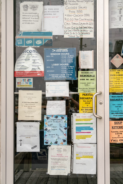Notices on the door at the post office.