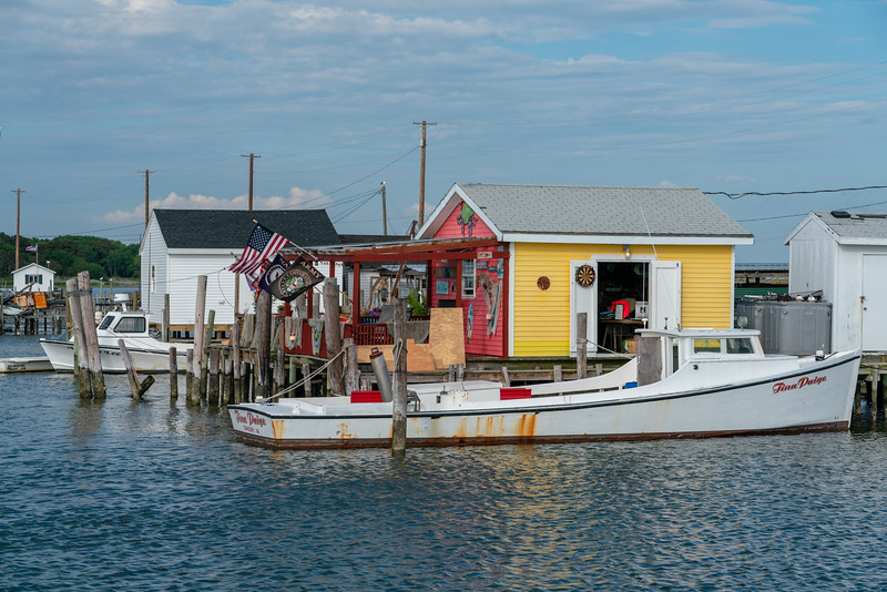 Tina Paige deadrise boat at a crab shack.
