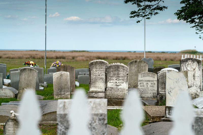 A cemetery with the bay beyond. So many Crocketts!