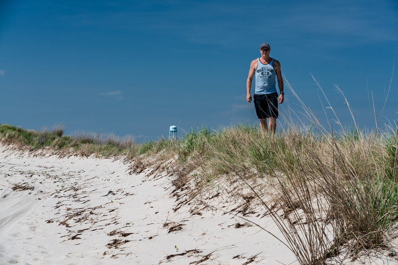 Tim walks the dunes.