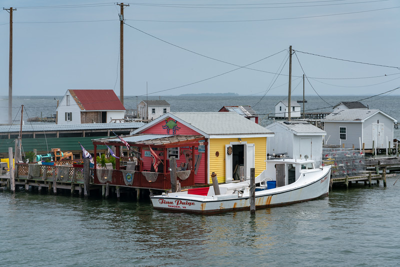 Crab shack and deadrise boat.