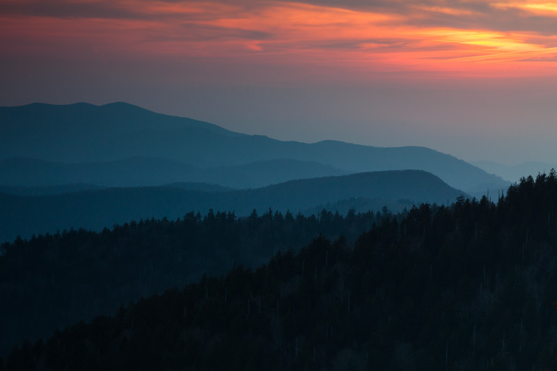 As the sunset approaches, the sun starts lighting the dense clouds in the sky. Great Smoky Mountains National Park, NC<br /> <br /> NC-120414-0010