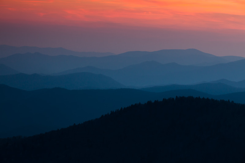 As the light fades, the mountain range turns hues of blue. Great Smoky Mountains National Park, NC<br /> <br /> NC-120414-0032