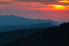 As the sunset approaches, the sun starts lighting the dense clouds in the sky. Great Smoky Mountains National Park, NC<br /> <br /> NC-120414-0013