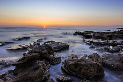 Waves moving through coquina rocks