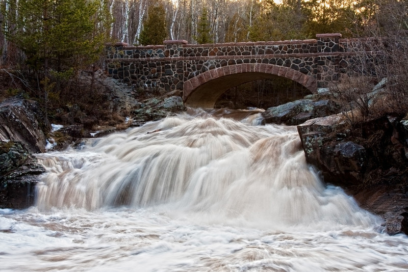 """""""Keep Smiling Falls"""" is located on Amity Creek and is so named thanks to the graffiti smiley face and the words """"Smile - it adds to your face value!"""".  This particular section of this chain of falls is located directly below the 6th bridge of Seven Bridges Road."""