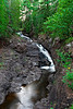 The French River Falls carve their way through the stone walls surrounding this North Shore waterfall.  4/4